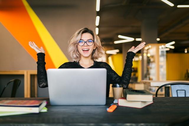 Woman happy doinng Online Learning